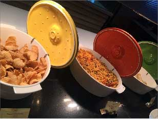Brightly-coloured cast-iron casserole dishes, Sofitel Downtown, Dubai